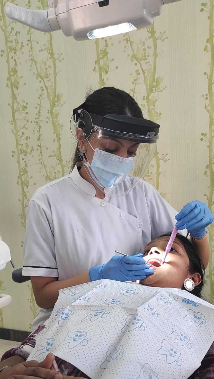 Dentist treatment Divine Smiles Dental Clinic 1 (1)